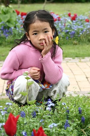 asian tulips: chinese girl in a tulips  garden in denmark