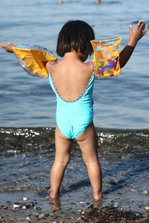 gladden: child  having fun with water  a summer day at the beach