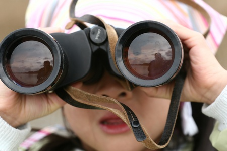 magnification: child with enormous magnification lenses