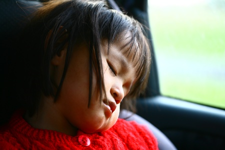 child sleeping in a car , close up picture on the head and face  photo