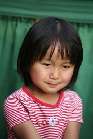 plenitude: cute chinese girl portrait in the sun