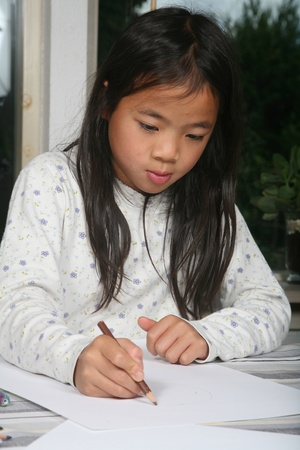child reading a book ans studying  (chinese child) photo