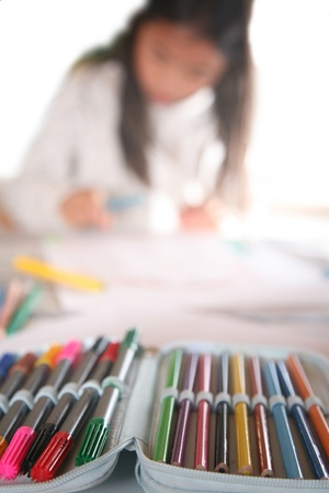 young child writting , painting and playing with colours (chinese child) Stock Photo