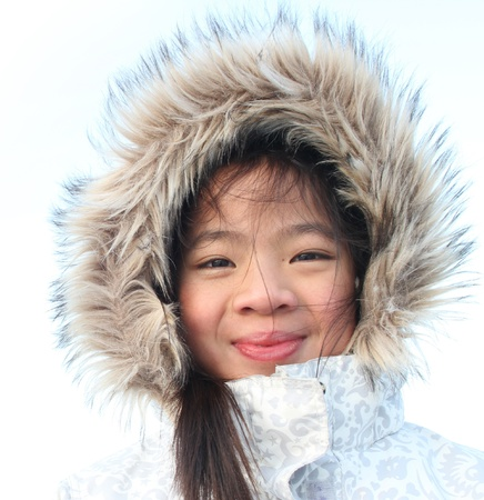 plenitude: Outdoor portrait of a child with hat in winter