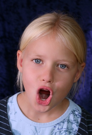 mouth  open: Close up of a child face while singing