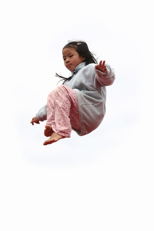 happy child outdoor jumping a summer day