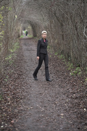 pretty woman outdoor walking in a forest Stock Photo - 10071265