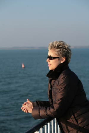 woman outdoor on a ferry deck photo