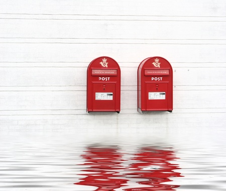 2 red post boxes and  and white wall in denmark Stock Photo - 9942847
