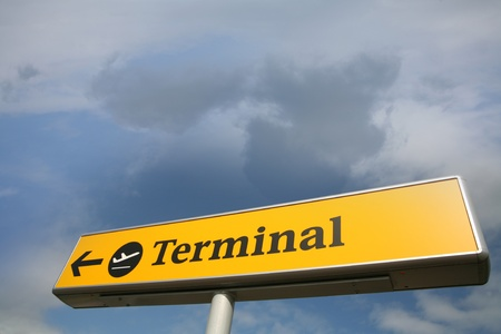 airplane terminal sign  in a blue sky with nice cloud formation  photo