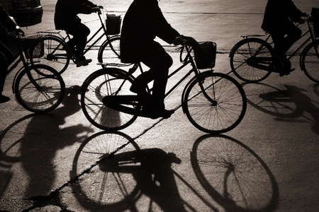 'cycles: Biking on a street in bejing china