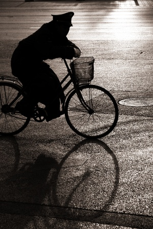 Biking on a street in bejing china photo