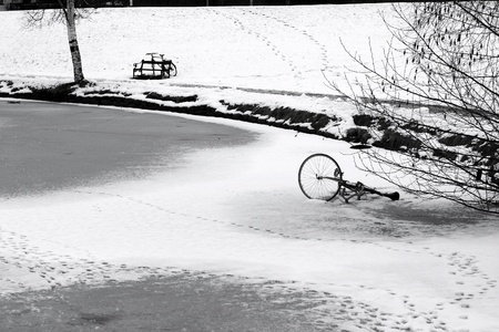 bike on an iced lake in  in a village in denmark