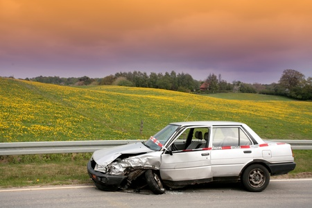 broken car: Car crash in denmark, accidented car parked on the road side Stock Photo
