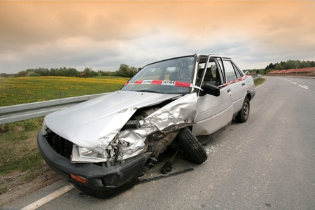 Car crash in denmark, accidented car parked on the road side Stock Photo