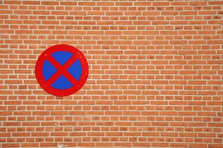 traffic  signs in a city:   parking sign on a brick wall photo
