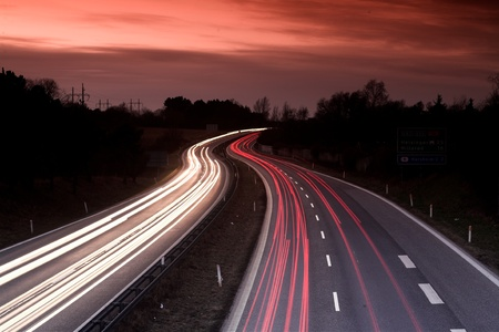 highway lights: night traffic in denmark shot from above (a bridge) with low shutter speed Stock Photo