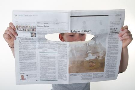 child reading newspaper