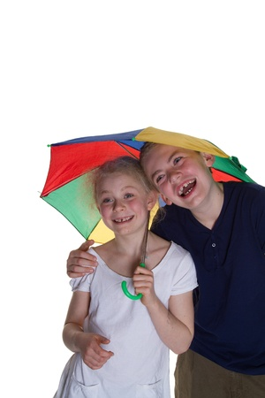 Kid with umbrella with white background; shot in studio photo