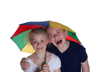 wheather: Kid with umbrella with white background; shot in studio