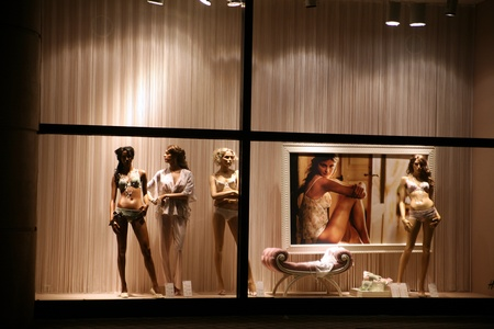 manequin: night time in the street of a city in anvers in belgium, manequin in a shop window  Editorial