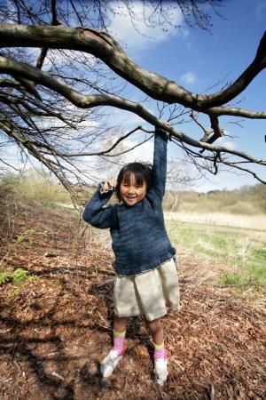 plenitude: child  having fun outdoor under a tree Stock Photo