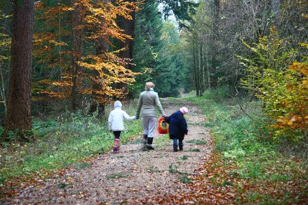 woman and children on a forest path photo