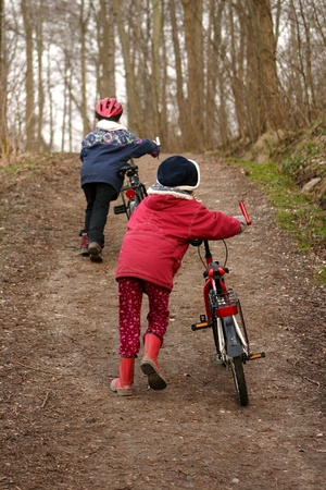 2 children with  bicycle in a forest man and  child in a forest photo