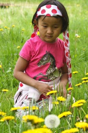 gladden: Cute girl in flowers in spring