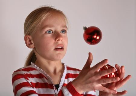 scandinavian girl: portait of a cute scandinavian girl in studio, juggling Stock Photo