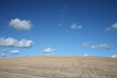 desertification: desert under  summer sky with nice cloud formation