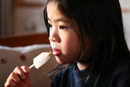 plenitude: close up of child eating