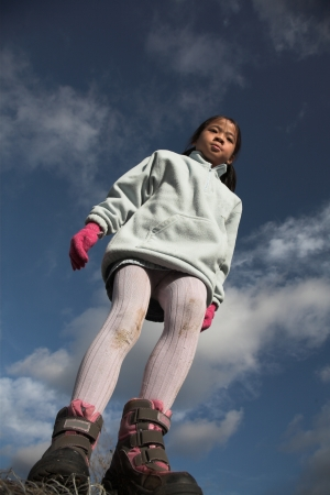 plenitude: happy child outdoor jumping a summer day against a blue sky Stock Photo