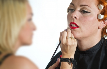make up artist: Make up artist at work on a red haired girl