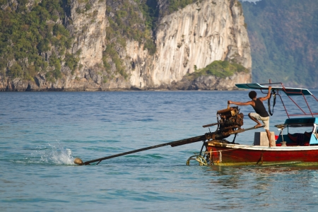 long tail: Long tail boat sailing  in Thailand
