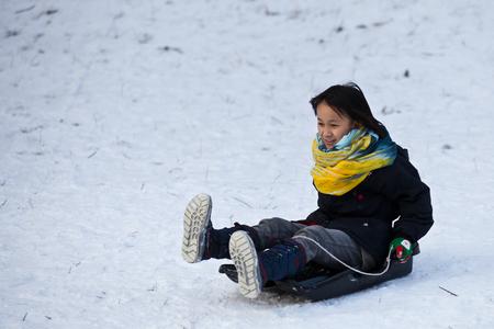 sledging: Girl sledging in winter in Denmark