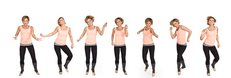 suppleness: Cute woman dancing on isolated white background Stock Photo