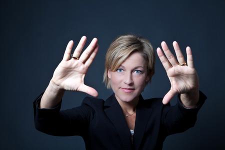 10 fingers: Woman standing shot in studio Stock Photo