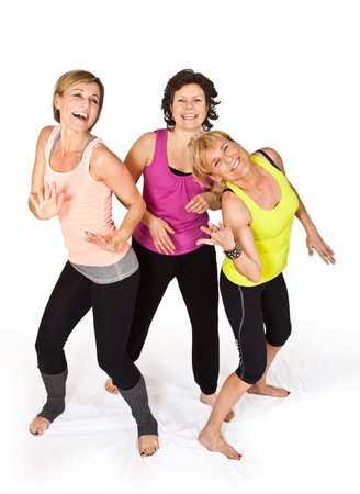 supple: Three cute woman dancing on isolated white background Stock Photo