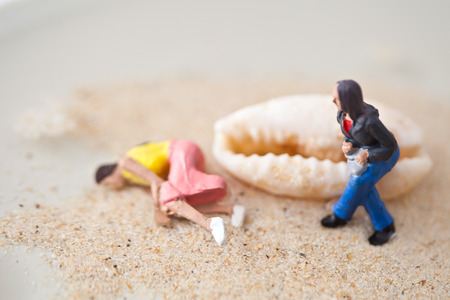 situations: Miniature people in action in various situations Stock Photo
