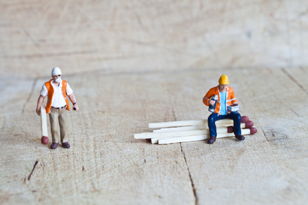 Miniature people in action in various situations Stock Photo
