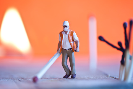 pyromaniac: Miniature people in action in various situations Stock Photo
