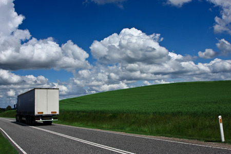 Weath cereal field in denmark in the summer. Truck passing photo