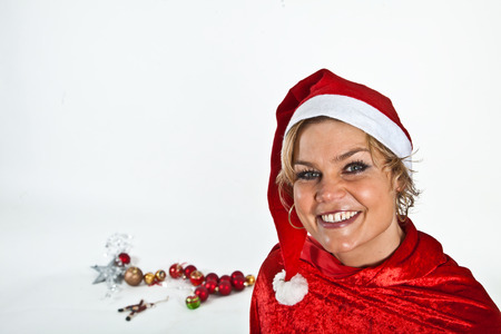 blond girl: Cute blond girl with christmas balls Stock Photo