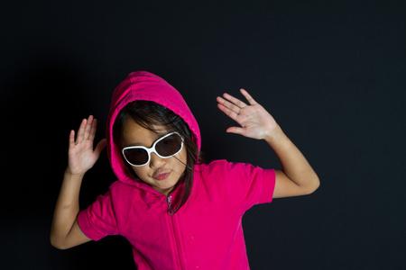 sudio: girl with sunglassesplaying smart in red