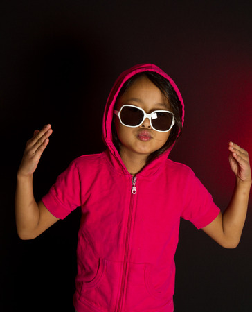 girl with sunglassesplaying smart in red