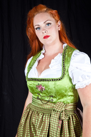 german girl: Red hair girl in pin-up style with a bavarian german dress
