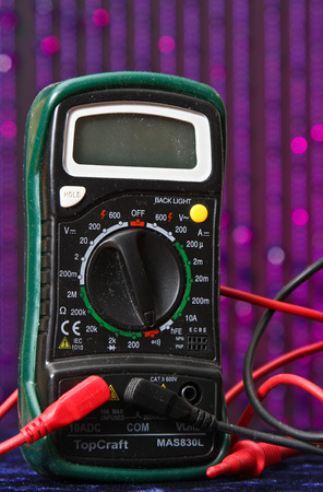 ampere: Electrical meter voltmeter with purple background