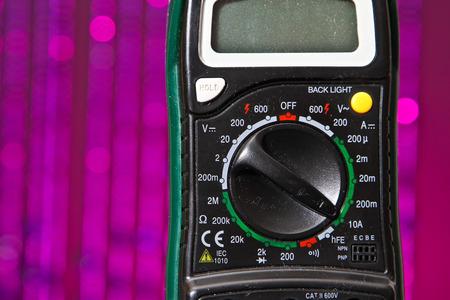 metering: Electrical meter voltmeter with purple background