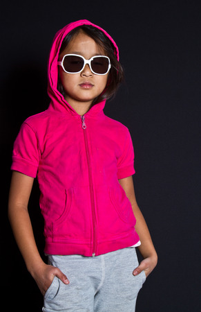 Girl with sunglasses playing smart in red